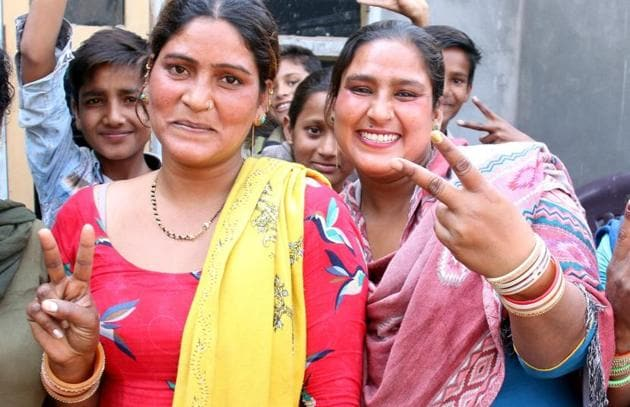 Maya and Rekha, the sisters of Indian Idol winner Sunny, in jubilant mood in Bathinda on Monday. The family is eagerly awaiting the singing sensation's return.(Sanjeev Kumar/HT)