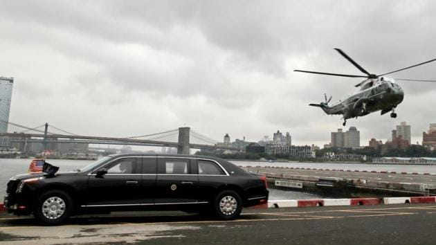 A Marine One helicopter carrying US President Donald Trump lands behind 'The Beast' in this file photo.(Reuters)