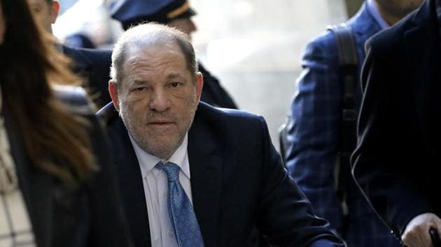 Harvey Weinstein, former co-chairman of the Weinstein Co., center, arrives with his attorney Donna Rotunno, left, at state supreme court in New York, U.S., on Monday, Feb. 24, 2020.(Bloomberg)