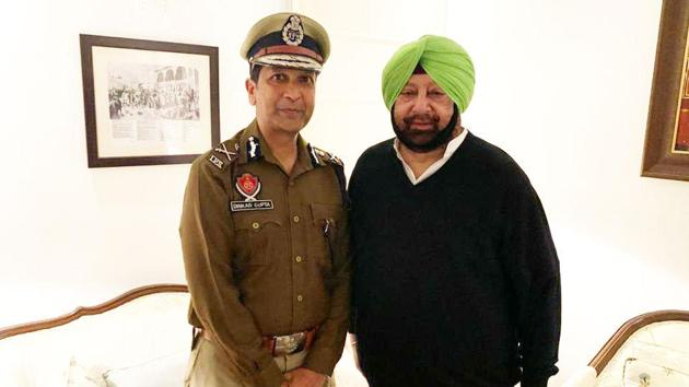 Chief minister Capt Amarinder Singh with Punjab Police chief Dinkar Gupta in Chandigarh. The CM defended the DGP in the assembly and gave details about the busting of terror modules and the recovery of arms and ammunition in the state over the past few months.(HT file photo)
