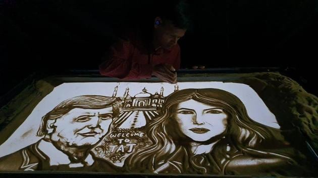 Sand animator Manas Kumar has created an art piece in which Donald Trump and Melania are seen in front of the Taj Mahal.(Facebook/Manas Kumar Sahoo)