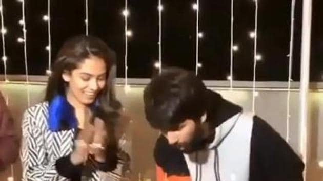 Shahid Kapoor cuts a cake to celebrate his 39th birthday as wife Mira Rajput looks on.
