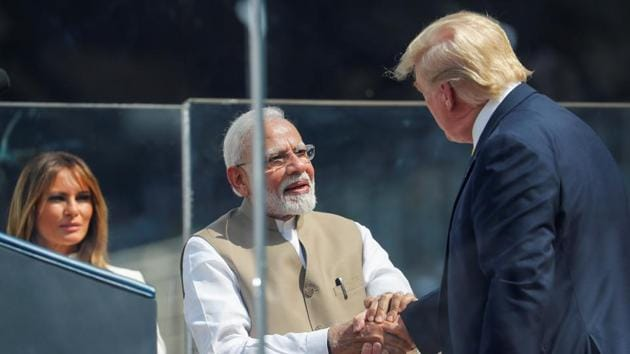 """US President Donald Trump and Indian Prime Minister Narendra Modi shake hands, as First lady Melania Trump looks on, at a """"Namaste Trump"""" event.(Photo: Reuters)"""