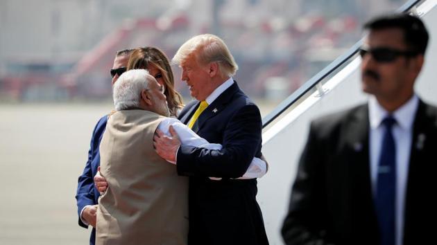 US President Donald Trump greets Indian Prime Minister Narendra Modi as he arrives at Sardar Vallabhbhai Patel International airport in Ahmedabad.(REUTERS)