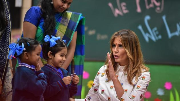 US First Lady Melania Trump interacts with school children during her visit to a government school to witness various activities as part of the 'happiness curriculum', in New Delhi on Tuesday.(PTI)