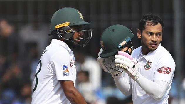 Bangladesh's Mushfiqur Rahim, right, and Mehidy Hasan stand between the wickets during the third day of first cricket test match between India and Bangladesh in Indore.(AP)