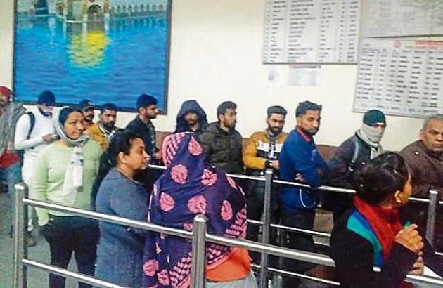 Passengers lined up outside the closed ticket counter at the Mohali railway station in the wee hours of Wednesday.(HT PHOTO)