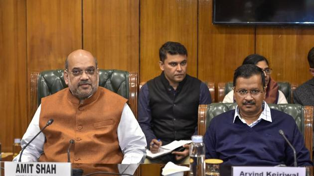 Union Home Minister Amit Shah (L) with Delhi Chief Minister Arvind Kejriwal during a high-level meeting to discuss the prevailing situation in the national capital after violence in northeast Delhi.(PTI)