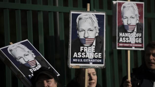 Supporters of Julian Assange hold placards as they protest on the second day of a week of opening arguments for the extradition of Wikileaks founder Julian Assange outside Belmarsh Magistrates' Court in south east London, Tuesday, Feb. 25, 2020.(AP)