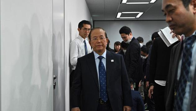 Chief executive officer of the Tokyo 2020 Olympics, Toshiro Muto (C) leaves after a media briefing in Tokyo on February 26, 2020. (Photo by Philip FONG / AFP)(AFP)
