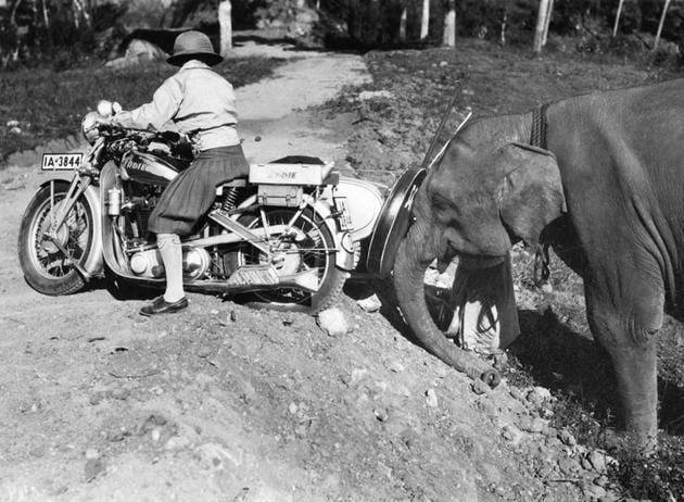 Road gods: German Hanni Koehler being pushed back onto a trail in India. Koehler was the first woman to travel overland on a motorbike - a 500cc Ardie Silberpfeil (Silver Arrow) - from Europe to Asia. Kandakarnan Swamy would have approved.(Getty Images)