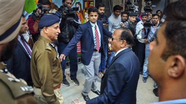 NSA Ajit Doval interacts with Special Commissioner of Police in Delhi SN Srivastava during his visit to the riot affected areas to assess ground situation, in north east Delhi.(PTI)