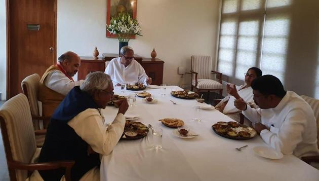 Odisha CM Naveen Patnaik hosted a lunch for Union Home Minister Amit Shah, Union Minister Dharmendra Pradhan, West Bengal CM Mamata Banerjee and Bihar CM Nitish Kumar at his residence in Bhubaneswar on Friday.(ANI PHOTO.)