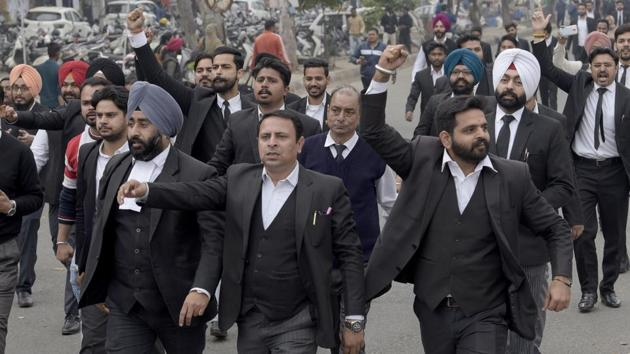 Members of the district bar association protesting outside the DC office in Ludhiana on Friday.(Gurpreet Singh/HT)