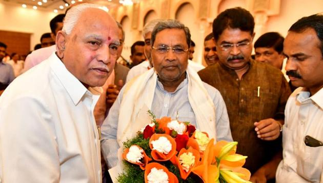 Former Karnataka CM and Congress leader Siddaramaiah with Karnataka Chief Minister BS Yediyurappa.(ANI PHOTO.)
