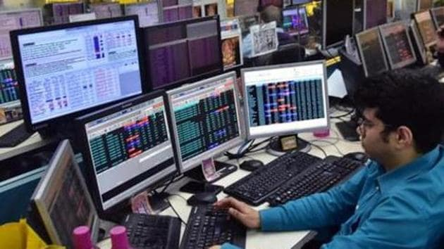 West Bengal, Jan 09 (ANI): Traders work on the floor as Sensex and nifty reach highest in share market, in Kolkata on Thursday. (ANI Photo)