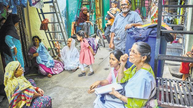 The researcher Mukul Ahmad (right) in Pune's Tadiwala road slum.(Milind Saurkar/HT Photo)