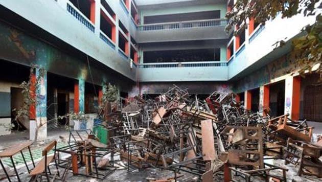 Remnants of a school following violent clashes over the new citizenship law at Shiv Vihar in New Delhi.(RAJ K RAJ/HT PHOTO.)