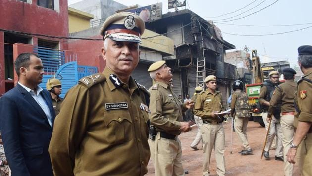 Newly appointed Delhi Police Commissioner S N Shrivastava visits violence affected areas at Shiv Vihar in northeast Delhi.(HT PHOTO.)