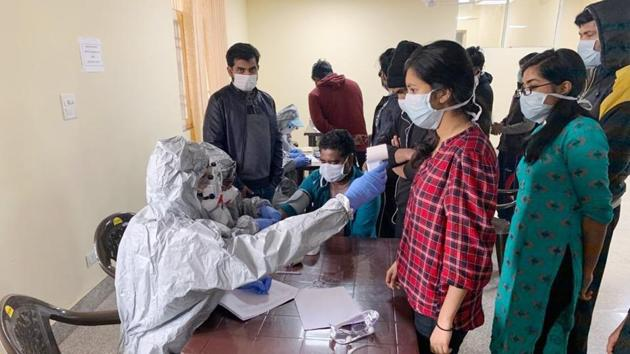 Indian nationals undergoing final sample collection and tests inside a quarantine facility set by up ITBP, at Chhawla area of New Delhi.(HT Photo)