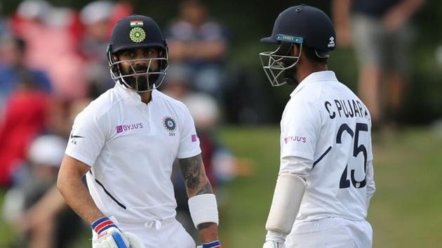 India's Virat Kohli and Cheteshwar Pujura during the match.(REUTERS)