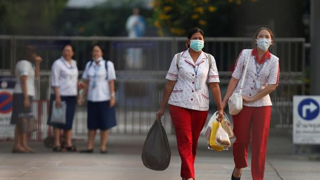 School staff leave after the government announced a 14-day closure as they found a 8-year old student was infected with coronavirus, at Phraharuthai Donmuang School in Bangkok, Thailand February 26, 2020.(Reuters Photo)