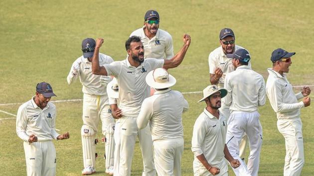 Bengal bowler Akash Deep (C) celebrates with his teammates after dismissing Karnataka batsman R Samarth(PTI)
