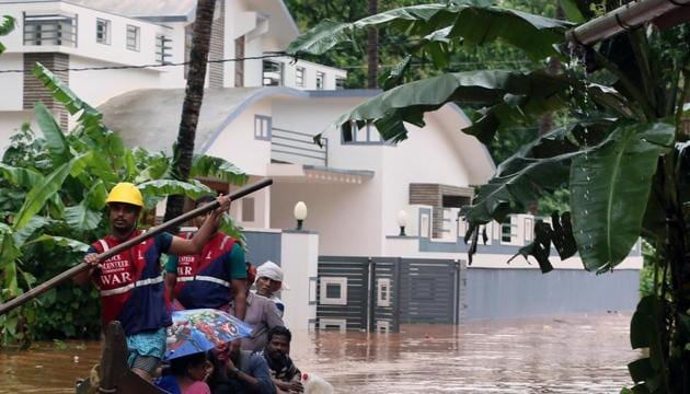 File photo: Police volunteers help people ride a boat during the flood at Chengalayi, in Kannur district of Kerala, India, on Thursday, August 8, 2019.(HT Photo)