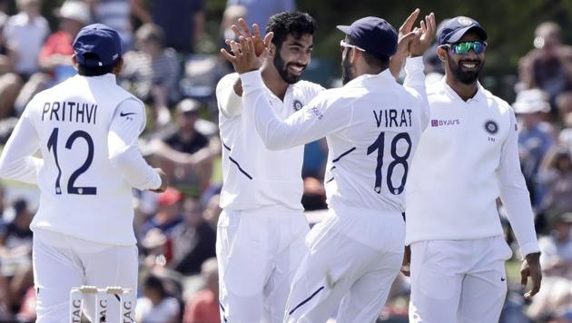 India's Jasprit Bumrah, centre, is congratulated by his captain Virat Kohli(AP)