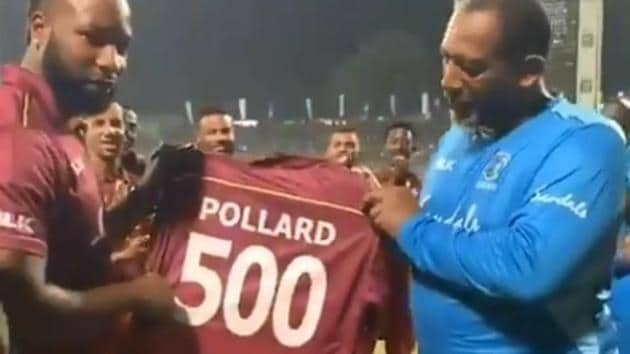 Kieron Pollard is presented with a special jersey.(WI/ Twitter)