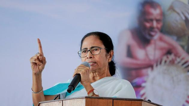 West Bengal Chief Minister Mamata Banerjee addresses an administrative review meeting at Kaliyaganj in North Dinajpur district, on Tuesday.(PTI Photo)