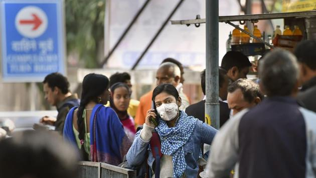 New Delhi: A young woman wearing a protective mask in the wake of novel coronavirus or COVID-19 outbreak, speaks on the phone at RML Hospital in New Delhi, Tuesday, March 3, 2020. India on Monday reported two new cases of the virus, including one from the national capital. The virus has so far killed more than 3,000 people globally. (PTI Photo/Ravi Choudhary)(PTI03-03-2020_000069A)(PTI)