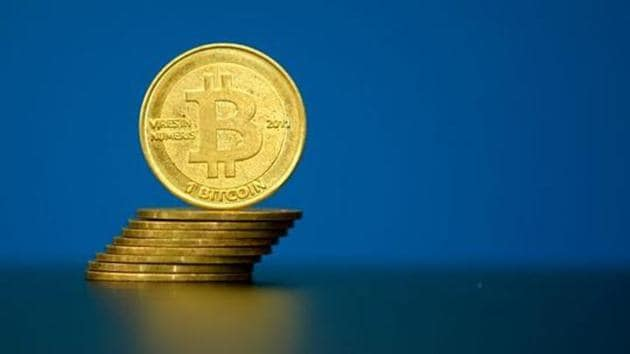"""Bitcoin (virtual currency) coins are seen in an illustration picture taken at La Maison du Bitcoin in Paris, France, May 27, 2015. British authorities have come out in support of digital currencies in the name of promoting financial innovation, while proposing that regulations should be drawn up to prevent their use in crime. But it is technophiles who are leading the drive to make London a real-world hub for trade in web-based """"cryptocurrencies"""", of which bitcoin is the original and still most popular. Picture taken May 27, 2015. REUTERS/Benoit Tessier(Reuters file photo)"""