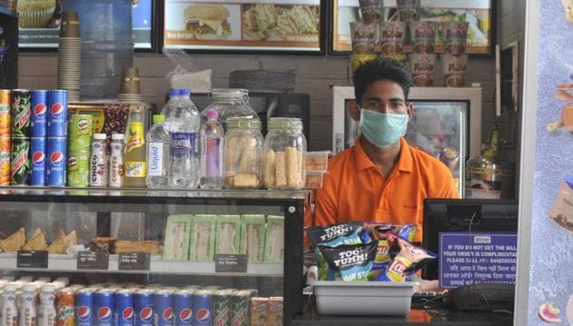 A shopkeeper is seen wearing a protective mask following positive cases of coronavirus in the country, at Chaudhary Charan Singh International Airport, in Lucknow, Uttar Pradesh.(Photo: Deepak Gupta / Hindustan Times)