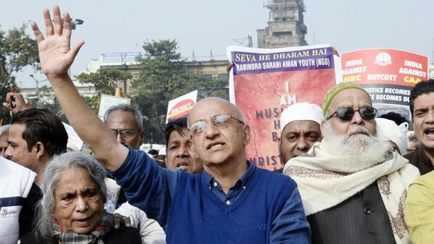 IAS turned social activist Harsh Mander along with supporters shout slogans during a protest against the CAA and NRC in Kolkata.(Photo: ANI)