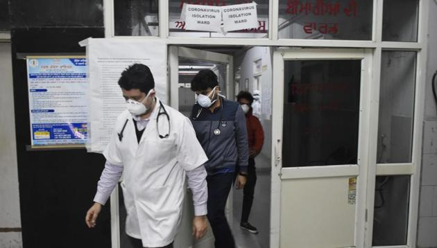 Doctors wearing masks inspection the isolation ward of Guru Nanak Dev Hospital after two Italy returned people have been diagnosed positive of Coronavirus in Amritsar.((Photo by Sameer Sehgal/Hindustan Times))