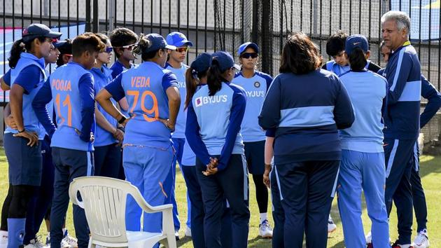 India's coach Woorkeri Raman (R) speaks to the players in the nets ahead of the Twenty20 women's World Cup cricket final.(AFP)