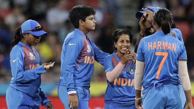 File image: India's Poonam Yadav, center, is congratulated by teammates.(AP)
