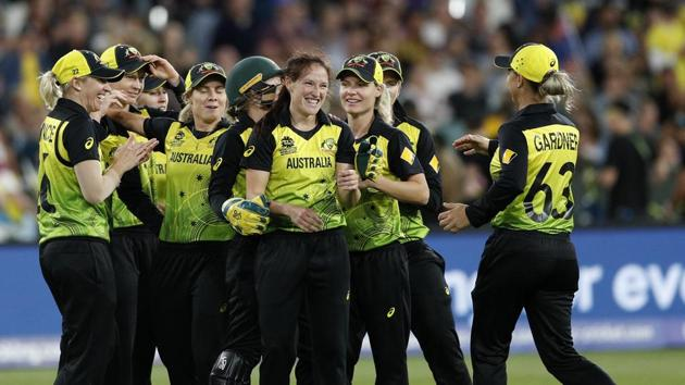 Australia's Megan Schutt, center, is congratulated by teammates after taking the wicket of India's Shikha Pandey during the Women's T20 World Cup cricket final match in Melbourne.(AP)