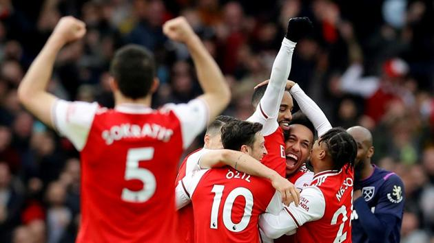 Arsenal's Alexandre Lacazette celebrates scoring their first goal with teammates(REUTERS)