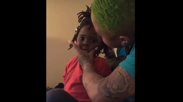 The video shows the hairdresser uplifting the little four-year-old after she exclaims she's ugly.(Instagram/lilwavedaddy)