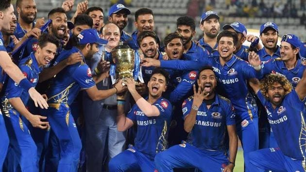 Mumbai Indians (MI) skipper Rohit Sharma with his teammates celebrating with Indian Premier League 2019 winning trophy after win over Chennai Super Kings (CSK) at the Final cricket match at Rajiv Gandhi International Cricket Stadium in Hyderabad.(PTI)