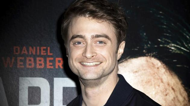 Actor Daniel Radcliffe poses for photographers upon arrival at a screening of the film Escape From Pretoria in London.(Grant Pollard/Invision/AP)
