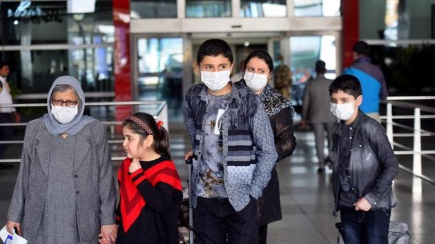 People seen wearing face masks as a preventive measure against the spread of Covid-19, at Indira Gandhi International (IGI) Airport in New Delhi on Thursday.(Amal KS/HT Photo)