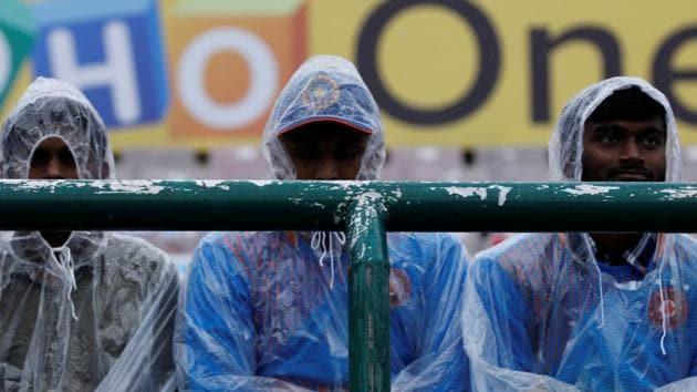 General view of fans wearing rain macs inside the stadium.(REUTERS)