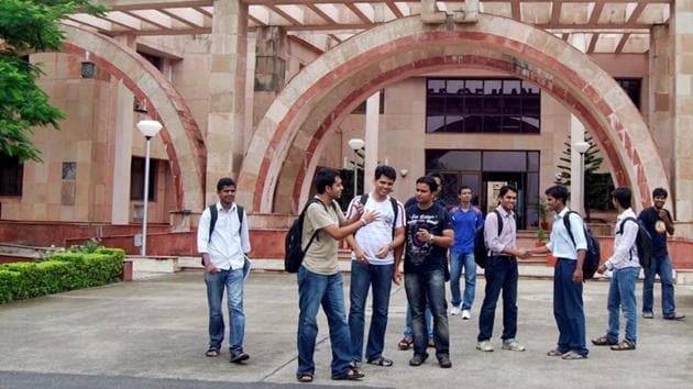 With item Arun Mondhe/HT IIM students outside their institute building in Indore.(Hindustan Times)