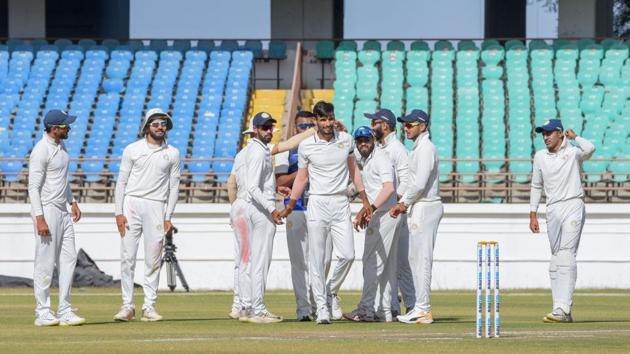 Rajkot: Saurashtra bowler Chirag Jani celebrates a wicket in Ranji trophy final(PTI)