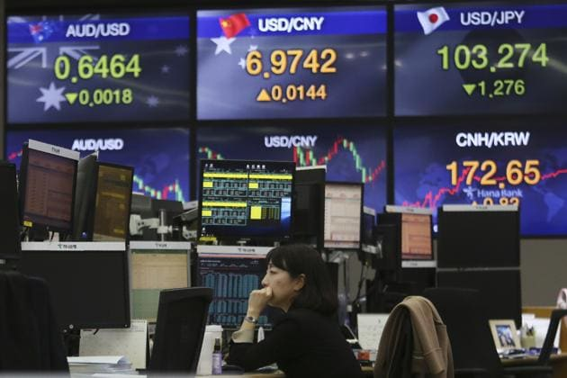 A currency trader watches monitors at the foreign exchange dealing room of the KEB Hana Bank headquarters in Seoul, South Korea on Thursday.(AP Photo)