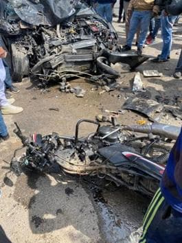 The mangled remains of the motorcycle and car after the accident on Mohali's Airport Road on Friday afternoon.(HT Photo)