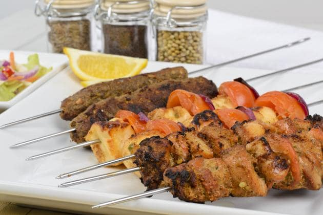 Most countries have some version of food on a stick. In India, there is, of course, the seekh kebab. But also kulfi, golas, cocktail snacks and, more recently, bite-sized desserts on skewers.(iStock)